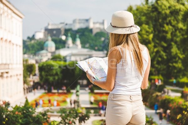 Stock photo: Female tourist on vacation in Salzburg Austria holding a local map