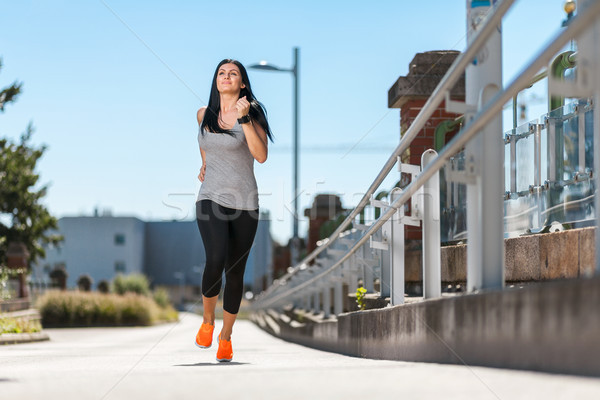 City workout. Beautiful woman running in an urban setting Stock photo © tommyandone