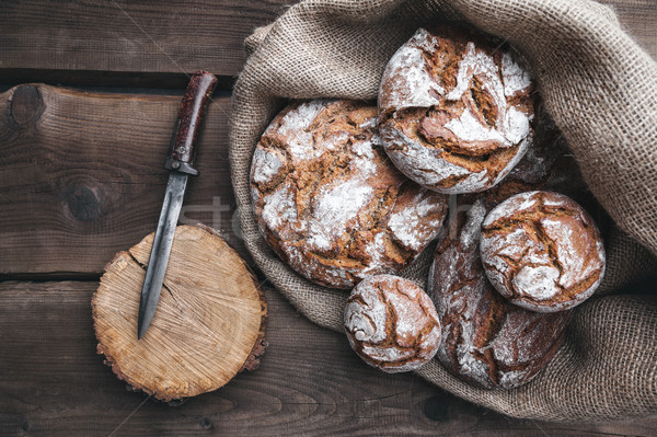 Delicious fresh bread inside a sack on wooden background Stock photo © tommyandone