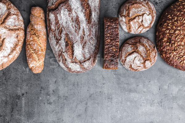 Delicious fresh brown bread on wooden background Stock photo © tommyandone