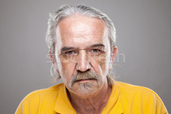 Stock photo: Portriat of an elderly man