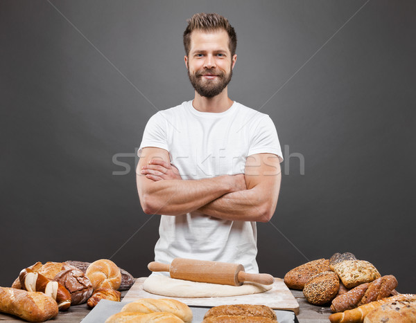 Baker with a variety of delicious freshly baked bread and pastry Stock photo © tommyandone