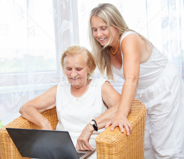 Stock photo: Helping out with new technology