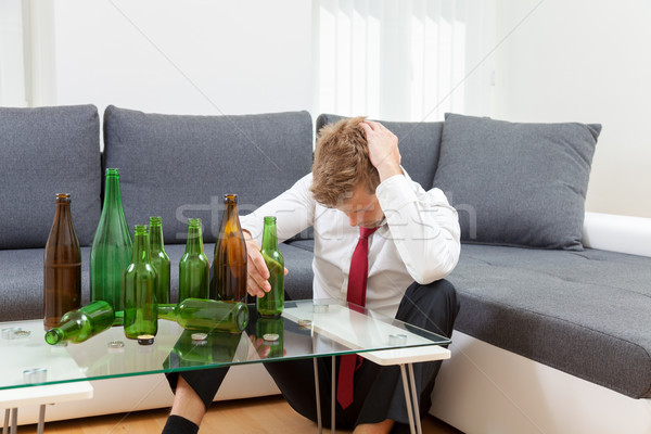 Deprimido empresário bêbado casa vazio garrafas Foto stock © tommyandone