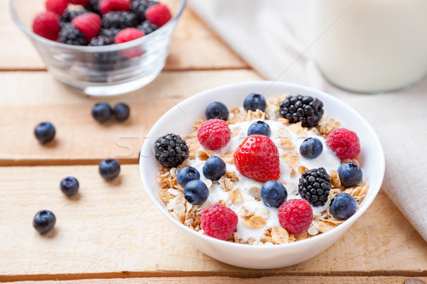 Healthy and nutritious yogurt with cereal and fresh raw berries Stock photo © tommyandone