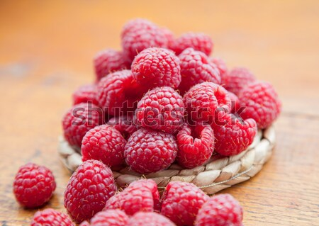Stock photo: Fresh and tasty raspberries on a wooden table