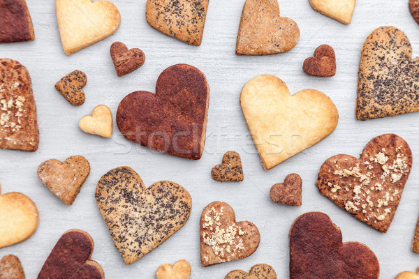 Love concept. Variety of heart cookies on grey background Stock photo © tommyandone