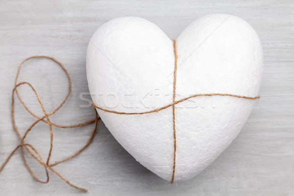 Heart bound by a string on grey background Stock photo © tommyandone