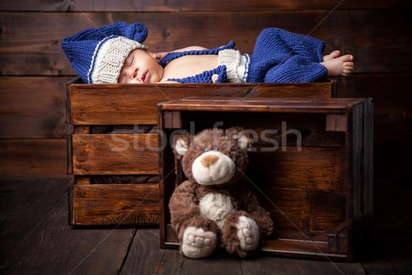 Sweet little newborn inside a wooden crate Stock photo © tommyandone