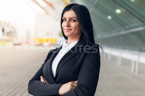 Beautiful young business woman in urban setting Stock photo © tommyandone