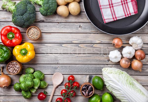 Légumes fruits herbes poêle bois Photo stock © tommyandone