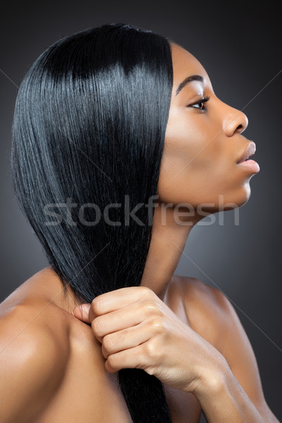 Black beauty with long straight hair Stock photo © tommyandone