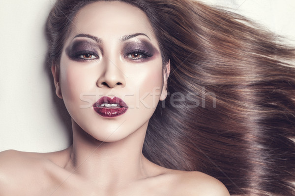 Beautiful young Thai woman with long elegant straight hair Stock photo © tommyandone