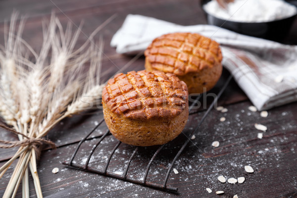 Delicious pastry on dark wooden background Stock photo © tommyandone