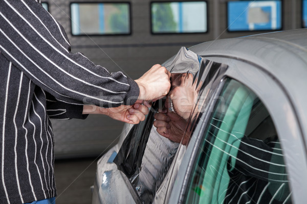 Applying tinting foil on a car window Stock photo © tommyandone