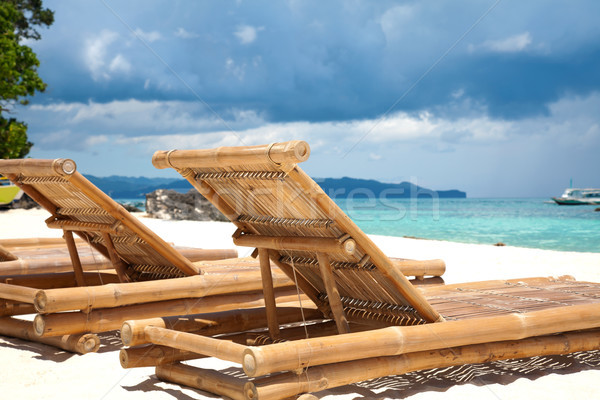Wooden deck chairs on beach Stock photo © tommyandone