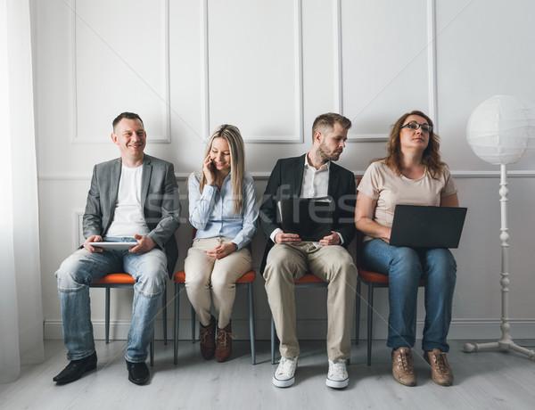 группа творческих людей сидят стульев зал ожидания молодые Сток-фото © tommyandone