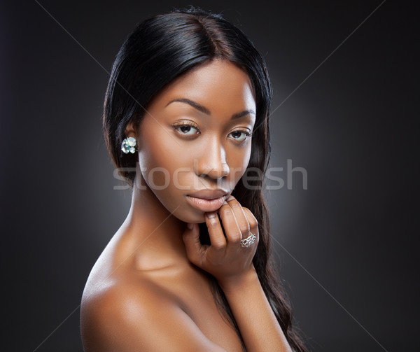 Young black woman with long hair Stock photo © tommyandone