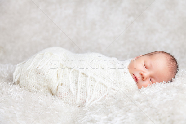Beautiful newborn wrapped in a blanket Stock photo © tommyandone