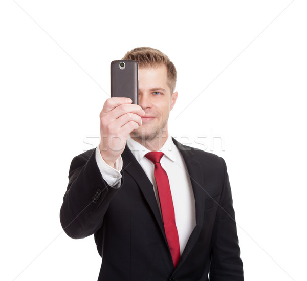 Handsome businessman taking a selfie Stock photo © tommyandone