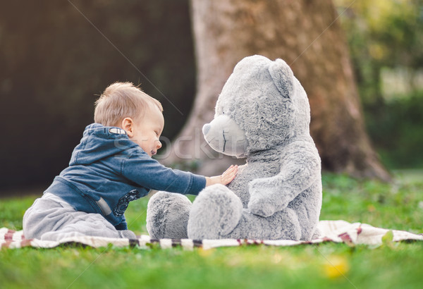 Best of friends. Cute toddler playing outdoors with his teddy bear  Stock photo © tommyandone