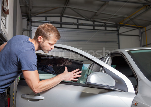 Applying tinting foil onto a car window  Stock photo © tommyandone