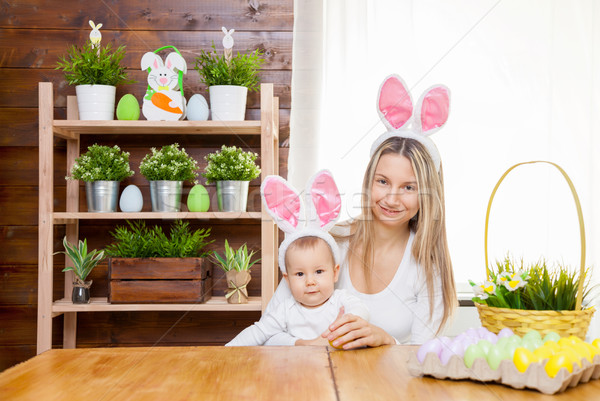 Happy mother and her cute child wearing bunny ears, getting ready for Easter  Stock photo © tommyandone