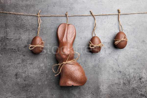 Delicious Easter chocolate bunny and eggs hanging on a string Stock photo © tommyandone