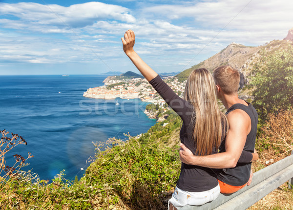 Happy couple enoying the view of Dubrovnik on their travels Stock photo © tommyandone