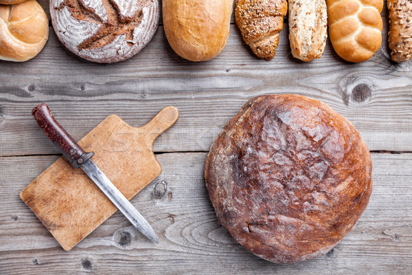 Delicious fresh bread on wooden background Stock photo © tommyandone