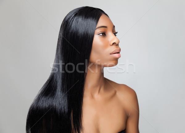 Mooie zwarte vrouw lang steil haar jonge vrouw Stockfoto © tommyandone