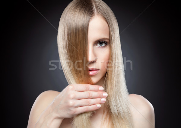 Profile of a beauty with long straight hair Stock photo © tommyandone