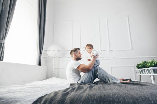 Boldog apa fia játszik otthon ágy apa Stock fotó © tommyandone