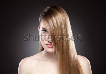 Young beauty with long straight hair Stock photo © tommyandone