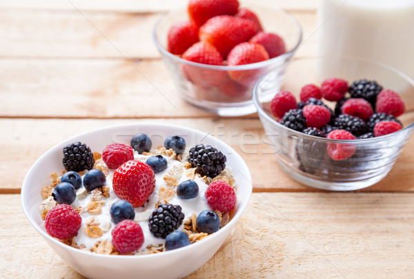 Healthy and nutritious yoghurt with cereal and fresh raw berries Stock photo © tommyandone
