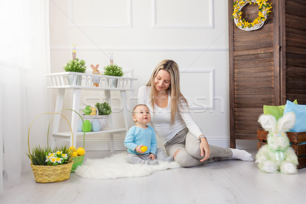 Delighted mother and her child enjoying the Easter egg hunt at home Stock photo © tommyandone