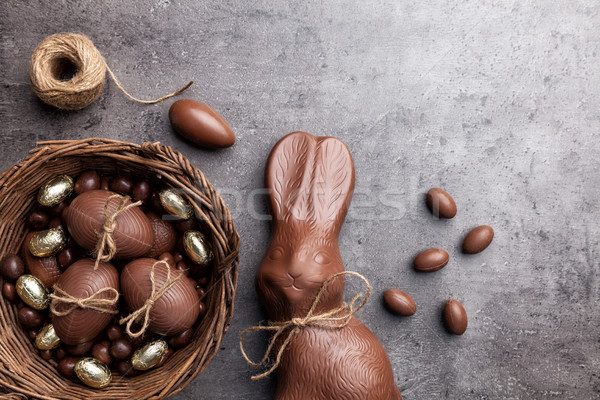 Stock photo: Chocolate Easter bunny and eggs on wooden background