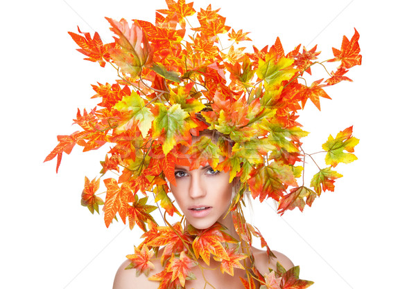 Beautiful young woman wrapped in leafs Stock photo © tommyandone