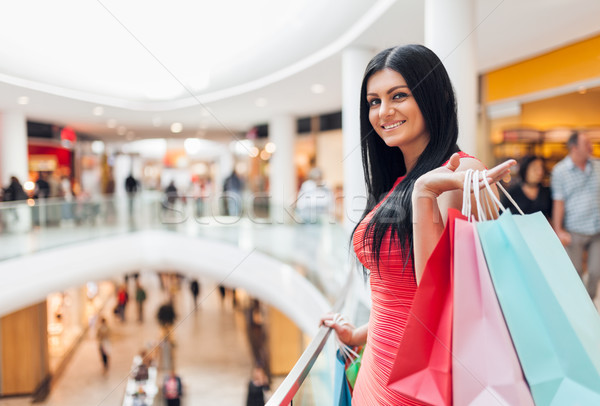 Beautiful woman with shopping bags at the mall Stock photo © tommyandone