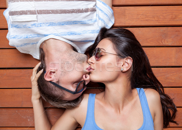 Happy young couple lying on a wooden floor Stock photo © tommyandone