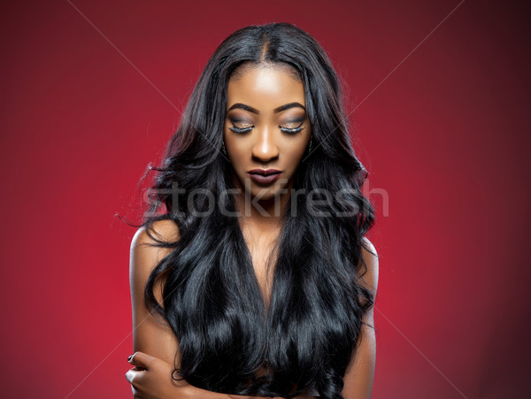 Black beauty with elegant curly hair Stock photo © tommyandone