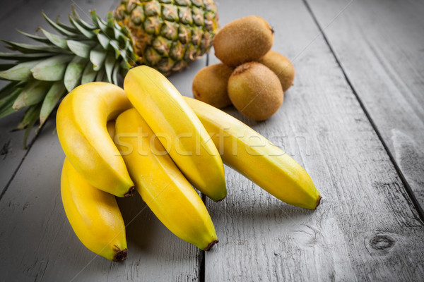 Delicious exotic fruit on grey wooden background Stock photo © tommyandone