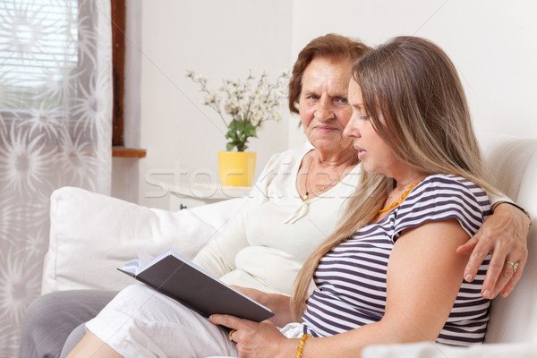 Carer spending time with an elderly woman Stock photo © tommyandone