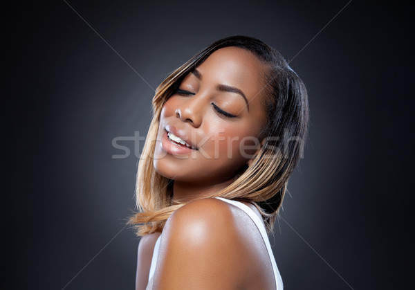 Black beauty with perfect skin smiling Stock photo © tommyandone