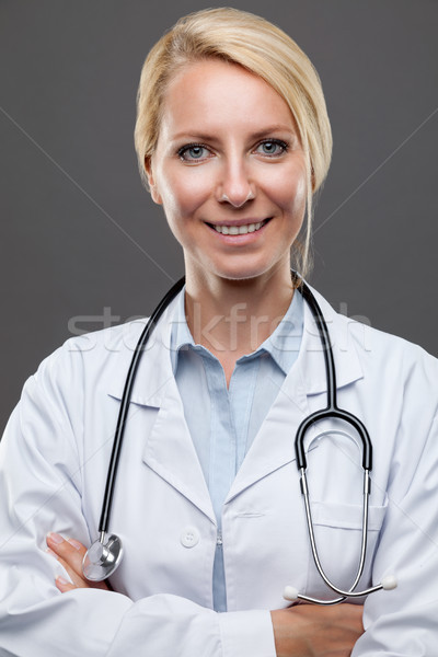 Portrait of a young female doctor Stock photo © tommyandone