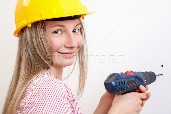 Woman doing the DIY work and wearing protective helmet Stock photo © tommyandone