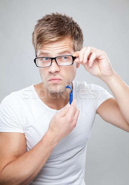 Jóképű férfi portré kéz szem arc férfi Stock fotó © tommyandone