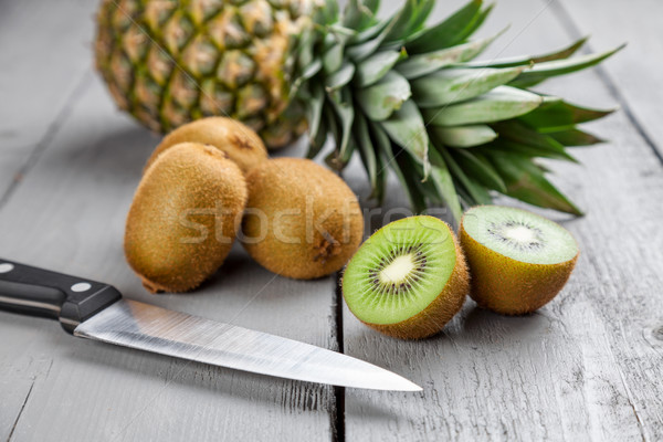 Kiwi ananas frutta grigio legno Foto d'archivio © tommyandone