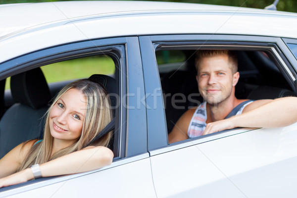 Young people enjoying a roadtrip in the car Stock photo © tommyandone