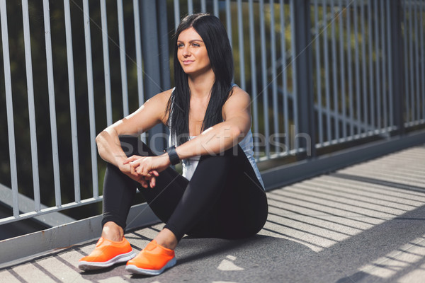 City workout. Beautiful woman with a smartwatch training in an urban setting Stock photo © tommyandone